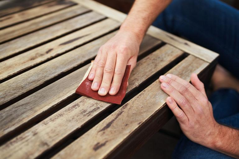 Sanding wood with sandpaper