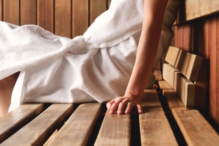 Woman sitting in an infrared sauna