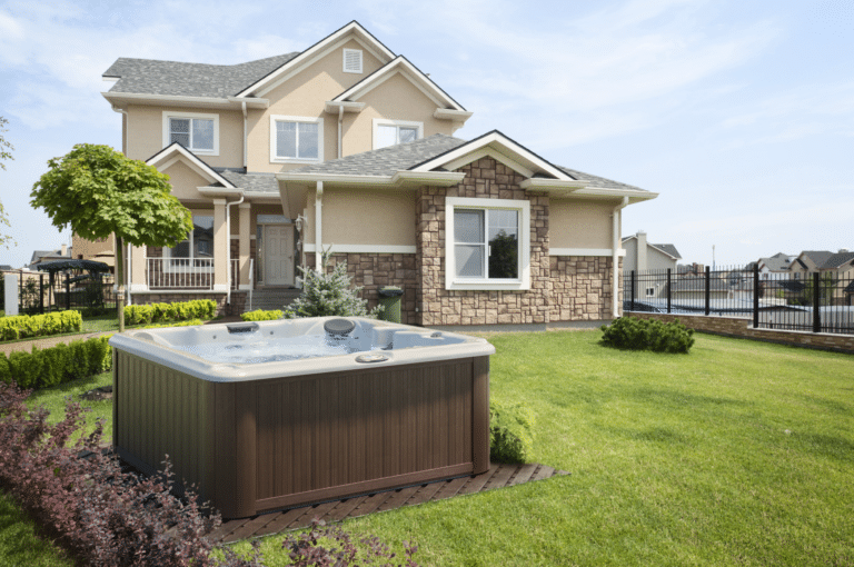 Outdoor hot tub installation outside of a luxury home